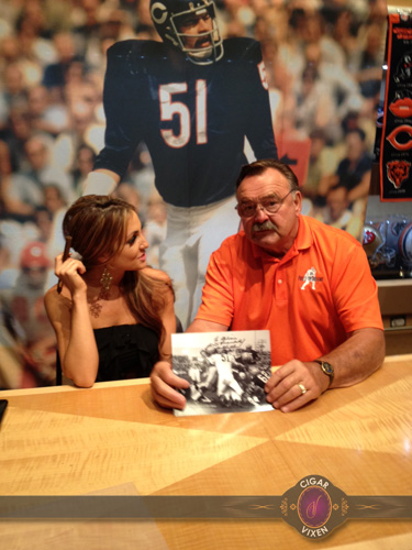 Cigar Vixen Sitting With Dick Butkus